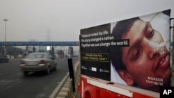 FILE - An anti-tobacco warning is seen on a road divider on the outskirts of New Delhi, India, Nov. 4, 2016.