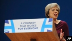 British Prime Minister Theresa May addresses delegates at the Conservative Party Conference at the ICC, in Birmingham, England, Oct. 5, 2016. May's government alarmed liberals by saying that businesses should prioritize hiring Britons.