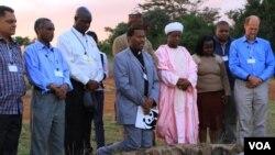 Representatives of the Christian, Muslim, Hindu, and Buddhist faiths pray for Africa's wildlife at the historic Ivory Burning Site in Nairobi National Park, Kenya, September 20, 2012. (J. Craig/VOA)