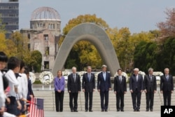 Secretary of State John Kerry joins other leaders and Japan's Foreign Minister Fumio Kishida at the Hiroshima Peace Memorial Park on April 11, 2016.