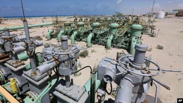 FILE - A general view of pipelines at the Zueitina oil terminal in Zueitina, west of Benghazi, April 7, 2014.