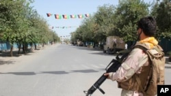 Pasukan Afghanistan berjaga saat baku tembak dengan kombatan kelompok militan Taliban di Provinsi Kunduz, utara Kabul, Afghanistan, 31 Agustus 2019.