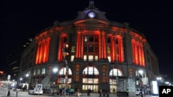 FILE - South Station is illuminated red to raise awareness for the bleeding disorders community on World Hemophilia Day, April 17, 2016, in Boston. A new gene therapy is offering hope for a cure for hemophilia.