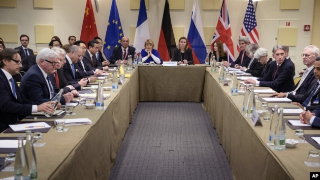 FILE - Representatives of world powers meet to pin down a nuclear deal with Iran, on March 30, 2015, in Lausanne, Switzerland.