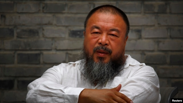 Chinese dissident artist Ai Weiwei sits on a chair in the courtyard of his studio, in Beijing, June 20, 2012.