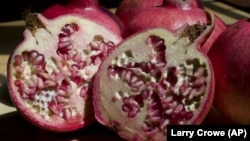 This file photo taken Sept. 3, 3009 shows sliced pomegranate. The ruby red fruit, which resembles a large apple but only its seeds are edible, is in season in September. (AP Photo/Larry Crowe)