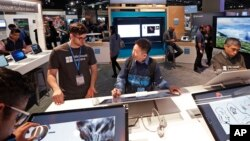 Workers demonstrate Microsoft devices at the Microsoft Build 2017 developers conference in Seattle, May 10, 2017.