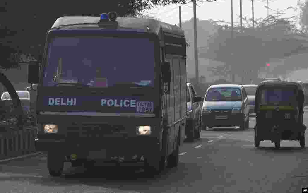 A Delhi state police van believed to be carrying the accused in a gang rape leaves the Saket district court in New Delhi, India, January 7, 2013.