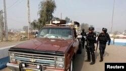 Policija na mestu incidenta u Bagdadu, 9. januar, 2014.