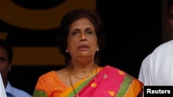 FILE - Former Sri Lankan President Chandrika Kumaratunga, who heads the reconciliation unit of President Maithripala Sirisena's government, says the war crimes court should start work by month's end or in early January.