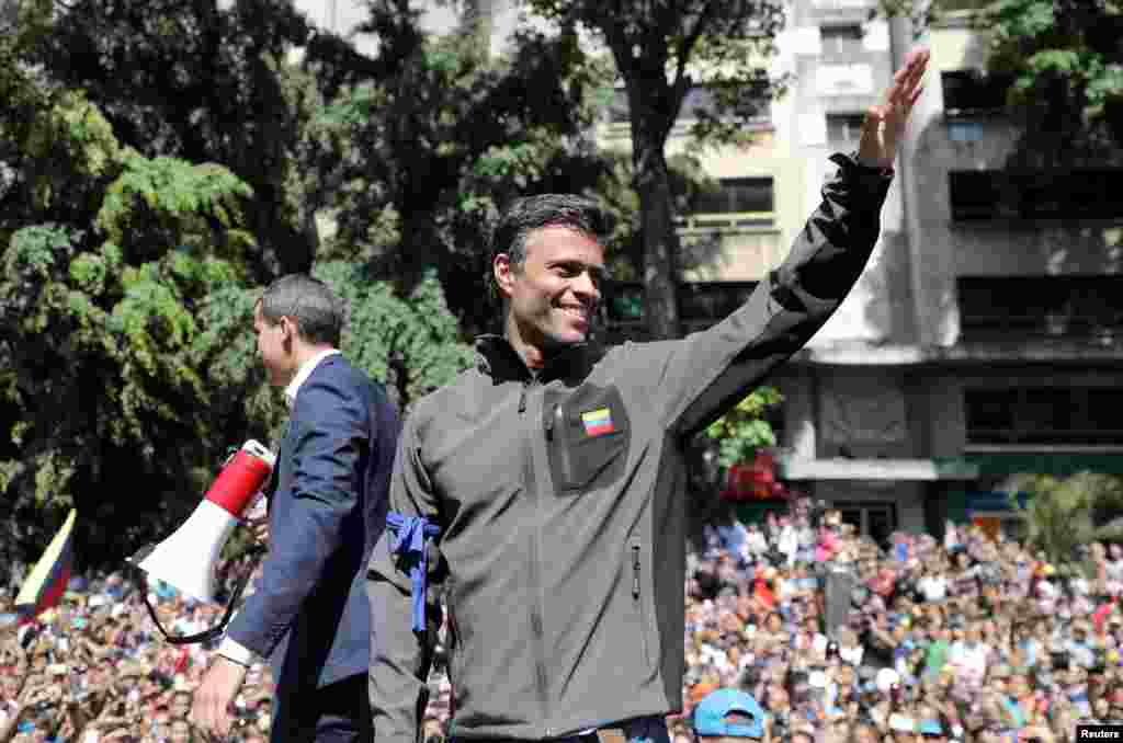 "Venezuelan opposition leader Juan Guaido, who many nations have recognized as the country's rightful interim ruler and fellow opposition leader Leopoldo Lopez address a crowd of supporters in Caracas. Lopez who had been put under house arrest by President Nicolas Maduro, was ""freed"" by soldiers supporting Guaido."