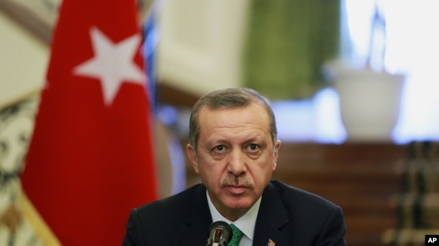 FILE - Turkish Prime Minister Recep Tayyip Erdogan attends a news briefing.