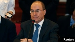 FILE - Israeli Energy Minister Silvan Shalom attends the signing ceremony of a joint declaration for establishing an industrial area in Jericho, July 2013.