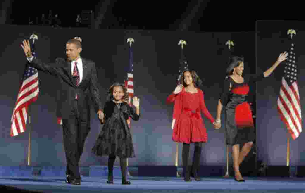 ** FILE ** In this Nov. 4, 2008 file photo, President-elect Barack Obama, left, his wife Michelle Obama, right, and two daughters, Malia, and Sasha, center left, wave to the crowd at the election night rally in Chicago. HBO has bought the U.S. rights to a