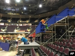 Workers prepare a camera platform inside Quicken Loans Arena in preparation for the Republican National Convention in Cleveland, June 28, 2016. No one will be able to carry weapons inside the smaller, secured area surrounding the arena, which will be controlled by the Secret Service.