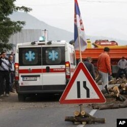 Local Serbs block access to border crossing in Jarinje on Kosovo-Serbia border to protest against Kosovo special police units operation overnight to take control of two disputed border crossings in Kosovo's northern Serb-run border region, July 26, 2011