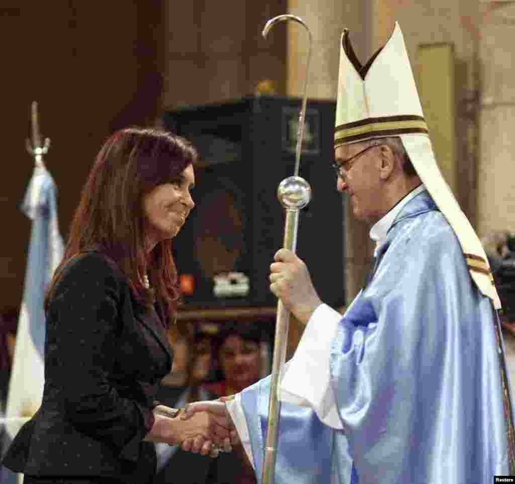 Argentine President Cristina Fernandez de Kirchner greets then Argentine Cardinal Jorge Bergoglio at the Basilica of Lujan, Dec. 22, 2008.