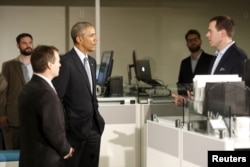 President Barack Obama greets employees on a tour of software development company InDatus in Louisville, Kentucky, where he stopped to highlight his TechHire jobs initiative, April 2, 2015.