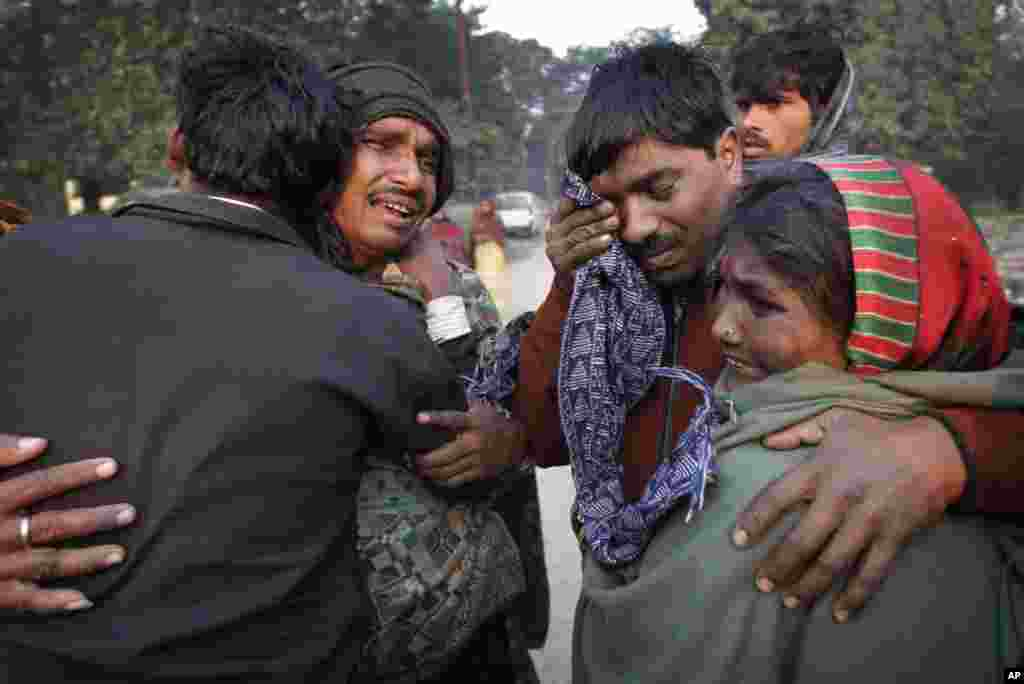 A family whose relative died in a stampede cry and comfort each other as they arrive to take the bodies from the morgue in Allahabad, India. The death toll from the stampede rose on Monday in the city where millions of devotees had gathered for a Hindu festival that is one of the world's largest religious gatherings.