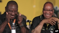 African National Congress (ANC) re-elected President Jacob Zuma, right, with his new deputy Cyril Ramaphosa, left, during their elective conference at the University of the Free State in Bloemfontein, South Africa, December 18, 2012.