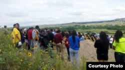 Mourners attend the burial of a 19-year-old Oglala Lakota girl on Pine Ridge Reservation, South Dakota, Aug. 17, 2015. (Photo courtesy of Keith Janis)