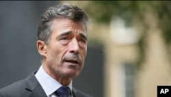 FILE - NATO Secretary General Anders Fogh Rasmussen.