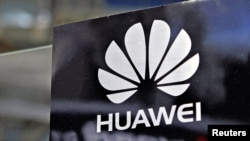 A Huawei logo is seen above the company's exhibition pavilion during the CommunicAsia information and communications technology trade show in Singapore on June 19, 2012.