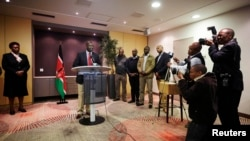 Deputy Kenyan President William Ruto addresses the media at a news conference at the Movenpick Hotel in the Hague, Netherlands, Oct.15, 2013.