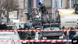 Special forces police install special equipment on a van in Ghent, western Belgium, Dec. 15, 2014.