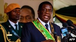 """FILE: President Emmerson Mnangagwa delivers a speech during Independence Day celebrations at the National Sports Stadium on April 18, 2018 in Harare. Zimbabwe on April 18 marked its first independence day without Robert Mugabe in power, with new leader Emmerson Mnangagwa vowing to hold """"credible"""" elections and turn around the southern African country's moribund economy. / AFP PHOTO / Jekesai NJIKIZANA"""
