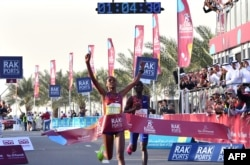 Ababel Yeshaneh crosses the finish line of RAK Half Marathon and breaks the half marathon world record on February 21, 2020 in United Arab emirate of Ras Al Khaimah. (Photo by GIUSEPPE CACACE / AFP)
