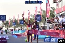 Ababel Yeshaneh crosses the finish line of RAK Half Marathon and breaks the half marathon world record on February 21, 2020 in United Arab emirate of Ras Al Khaimah. (Photo by GIUSEPPE CACACE / AFP)