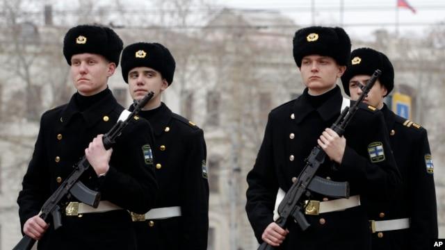 Ukrainian sailors march in the Ukrainian Black Sea port of Sevastopol in the Crimea, Ukraine, Feb. 24, 2014.