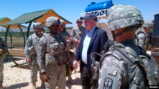 Senator John McCain is pictured with U.S. troops at a Patriot missile site in southern Turkey, May 27, 2013 in this picture released via McCain's Twitter account.