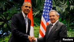 U.S. President Barack Obama and Cuba's President Raul Castro shake hands during their first meeting on the second day of Obama's visit to Cuba, in Havana, March 21, 2016.
