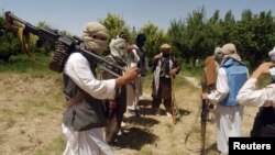 FILE - Taliban fighters are seen in an undisclosed location in Afghanistan, July 14, 2009.