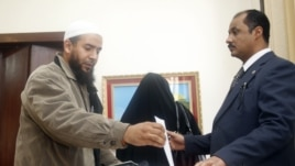 An Egyptian expatriate living in Qatar casts his ballot on the new Egyptian constitution, in Doha, December 12, 2012.