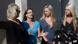 Bonnie Schaan, second from left, discuss her daughter, Cheyeanne Fitzgerald, who was wounded in the shooting at Umpqua Community College, during a news conference outside Mercy Medical Center, Saturday, Oct. 3, 2015, in Roseburg, Oregon.