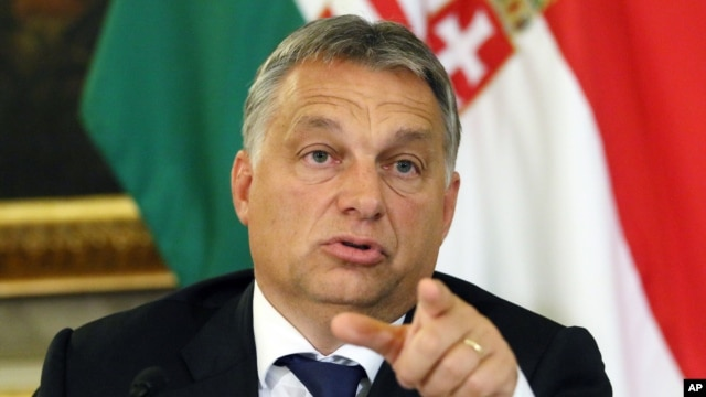 FILE - Hungarian Prime Minister Viktor Orban, shown at a September press conference, has become a divisive figure throughout Europe.