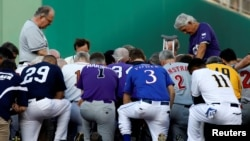 Father Pat Conroy, Chaplain of the House of Representatives, leads members of the Republican and Democratic Congressional baseball teams in prayer prior to the Congressional Baseball Game at Nationals Park in Washington, June 15, 2017.