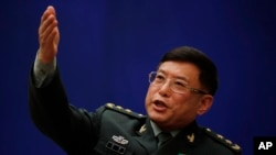 Vice president of China's Academy of Military Sciences, Lt. Gen. He Lei gestures as he speaks during a press conference on the sidelines of the National People's Congress at the State Council Information Office in Beijing, March 8, 2018.