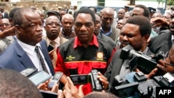 FILE - Opposition United Party for National Development president Hakainde Hichilema (C) talks to journalists in Lusaka, March 2, 2016.