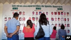 Photographs of the missing are on display at the future site of the Victims' City in Iguala, Guerrero State, Mexico, Nov. 22, 206.