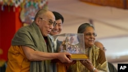 Tibetan spiritual leader the Dalai Lama receives the Mahatma Gandhi International Award for Reconciliation and Peace from Ela Gandhi, the granddaughter Mahatma Gandhi, as the Prime Minister of the Tibetan government-in-exile Lobsang Sangay, extreme right,