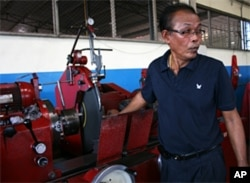 Red shirt businessman Narong Meephet at his machine shop in Udon Thani