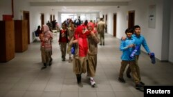 Students of Tevfik Ileri Imam Hatip School walk along a corridor as they leave their classroom for a break in Ankara, Nov. 18, 2014.