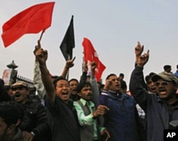 Supporters of Nepal's Mohan Baidya-led Maoist faction protest in Katmandu against the country's four main parties to integrate one-third of the former Maoist rebels into the army and give money to the remainder, November 2, 2011.