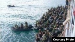 美日在關島進行海上聯合軍演(日本防衛省的官方照片)