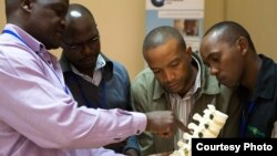 Lancet Commissioner Professor Nyengo Mkandawire from the Malawi College of Medicine teaching at the COOL-funded spine surgery course at AIC-CURE Children's Hospital in Kijabe, Kenya in April 2014. The spine course was led by Professor Chris Lavy from the Nuffield Orthopaedic Centre in Oxford (also a Lancet Commissioner).
