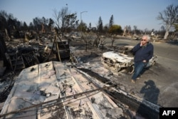 Homeowner Phil Rush reacts as he looks at the remains of his home destroyed by wildfire in Santa Rosa, Calif., Oct. 11, 2017. Rush said he and his wife and dog escaped with only some medication and a bag of dog food when flames overtook their entire neighborhood Oct. 9.